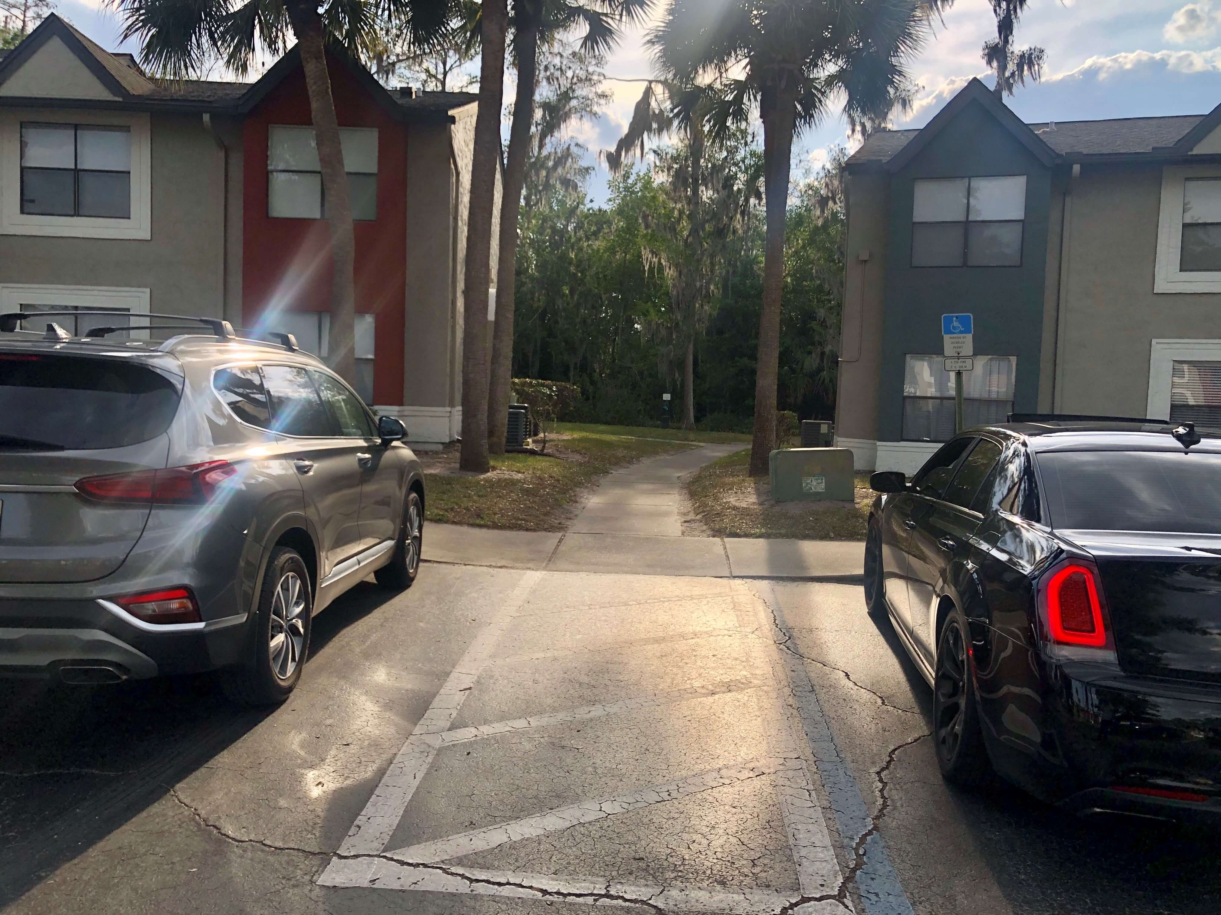 Handicap parking, with wheelchair accessible path leading to the apartments.