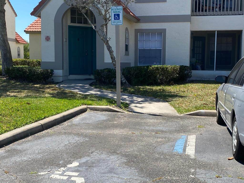 Dedicated handicap parking area in front of apartment complex.