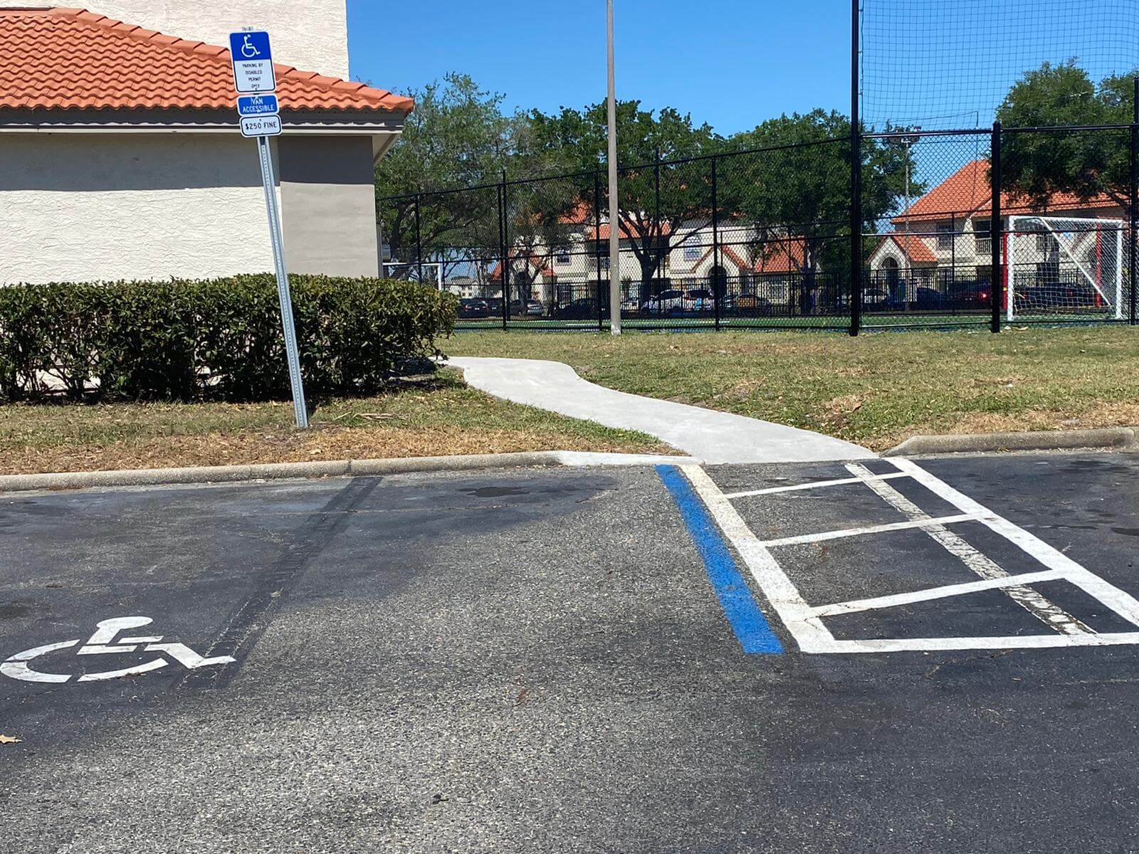 Dedicated handicap parking space that is van accessible with an accessible pathway leading to the racquetbal court.
